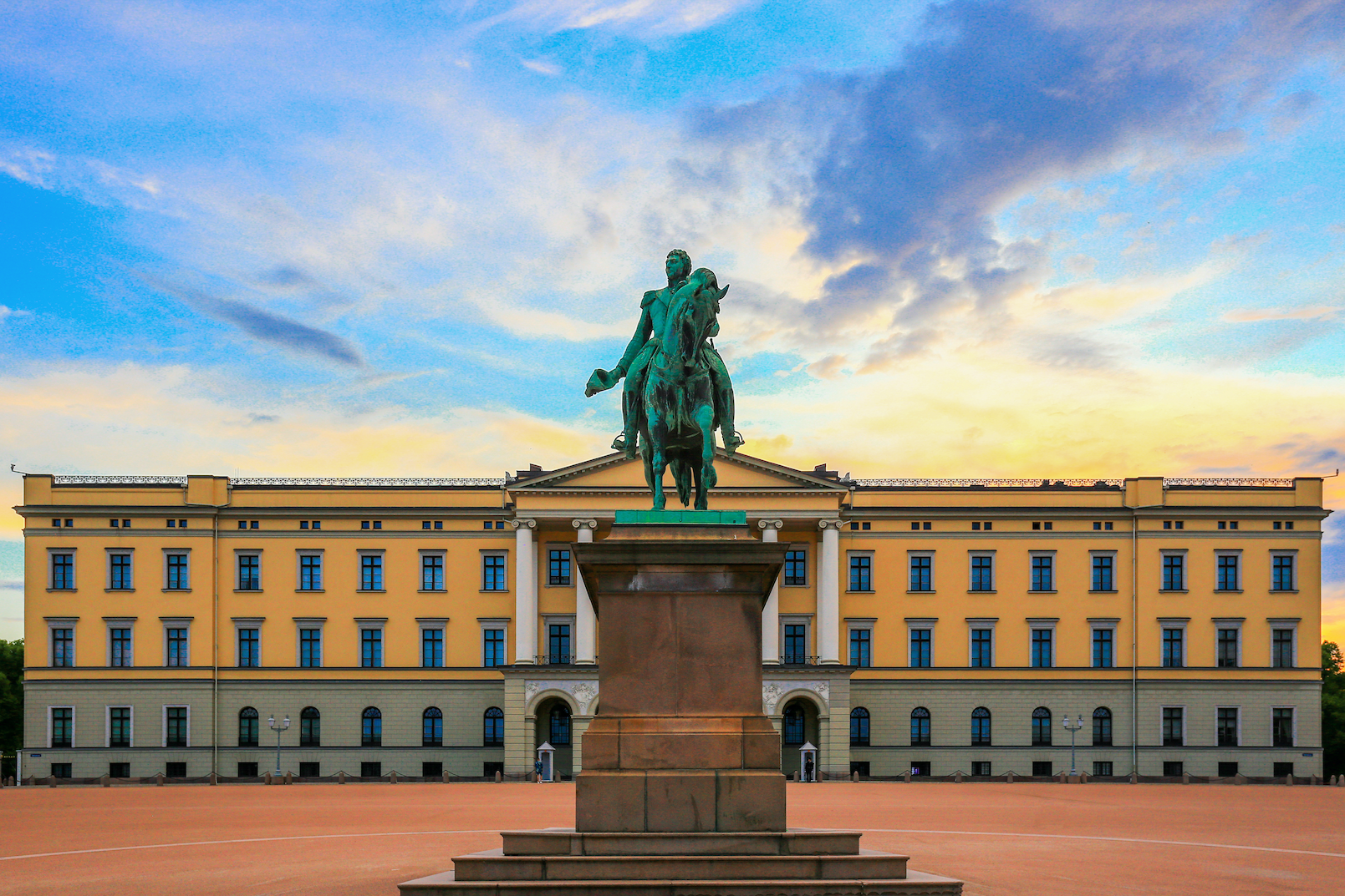 View of the Oslo Royal Palace at sunset.